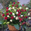 Large basket with roses and lilies to order in Kiev