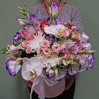 "Bouquet in a hatbox with blue eustoma and palinopsia ""Vivat"""